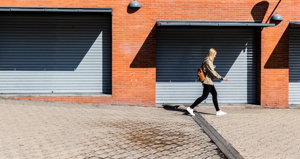 man walking on running bone pavement