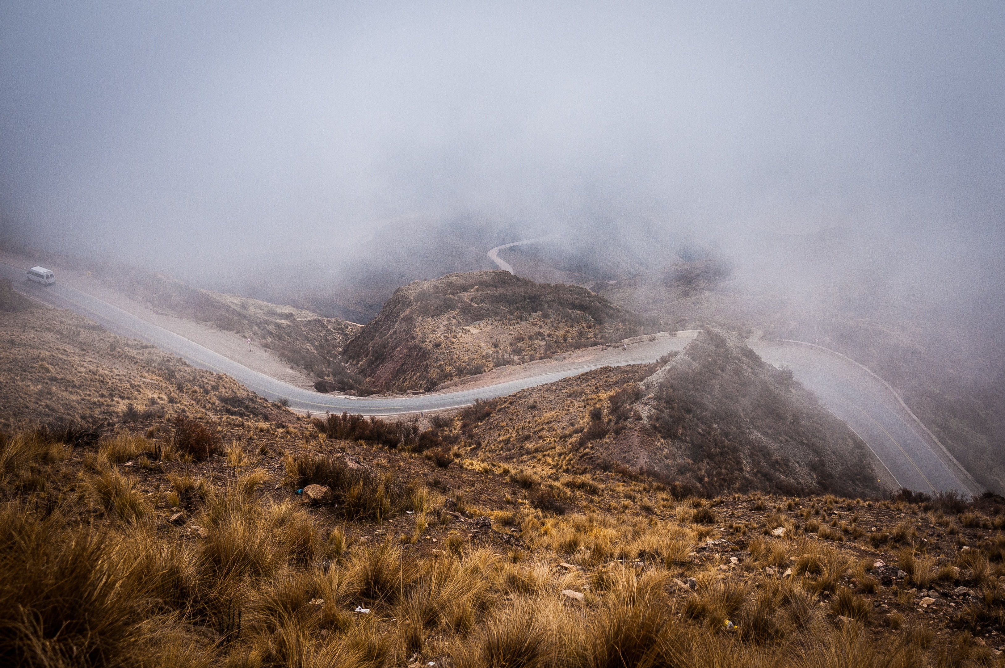 Winding country roads through the misty hills of Parque Nacional Los Cardones