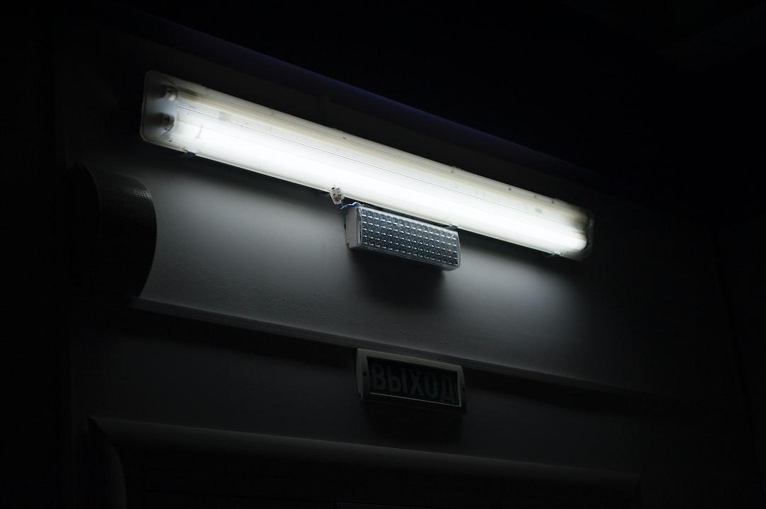 A long fluorescent lamp in a dark interior