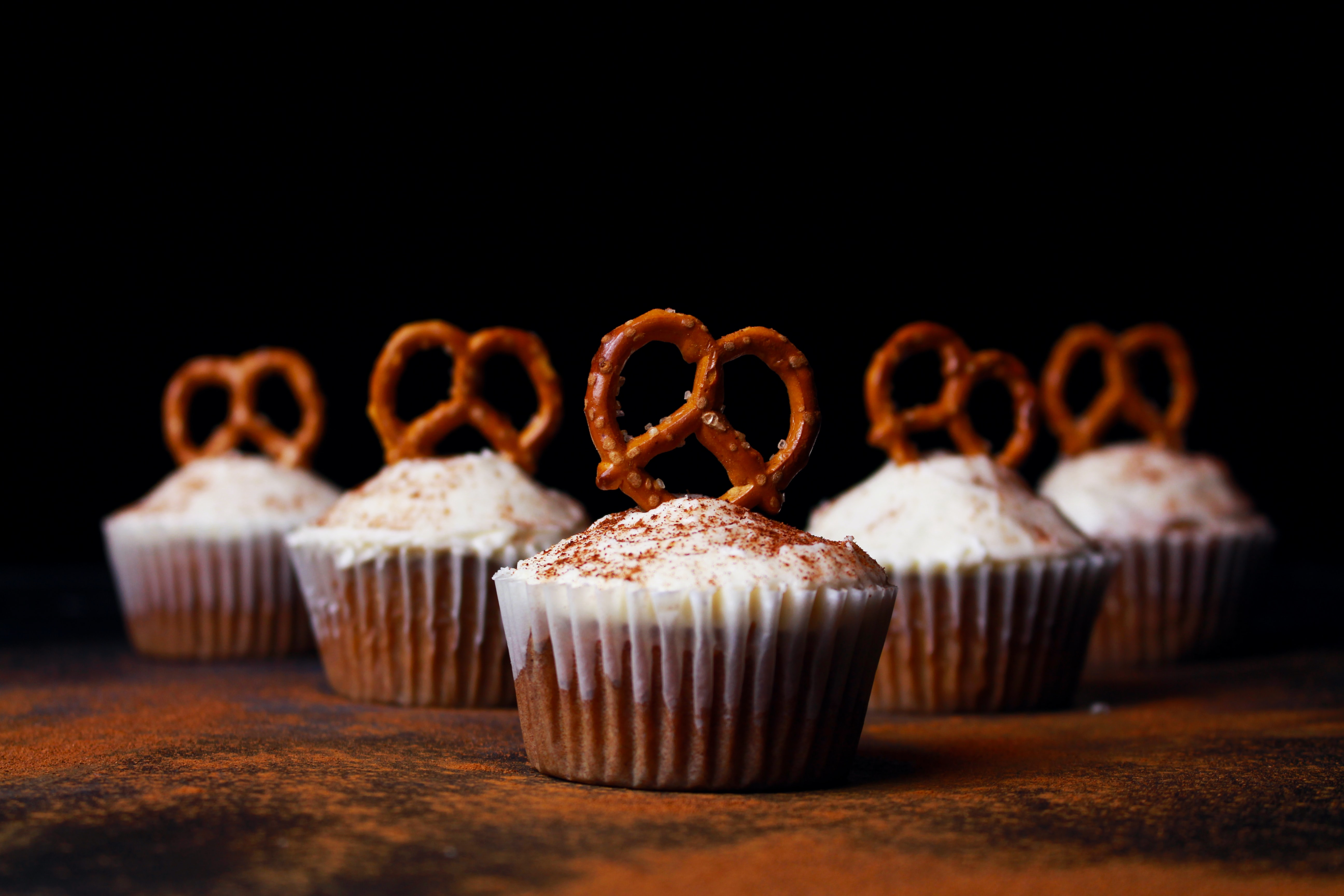 Homemade cupcakes topped with cinnamon and pretzels