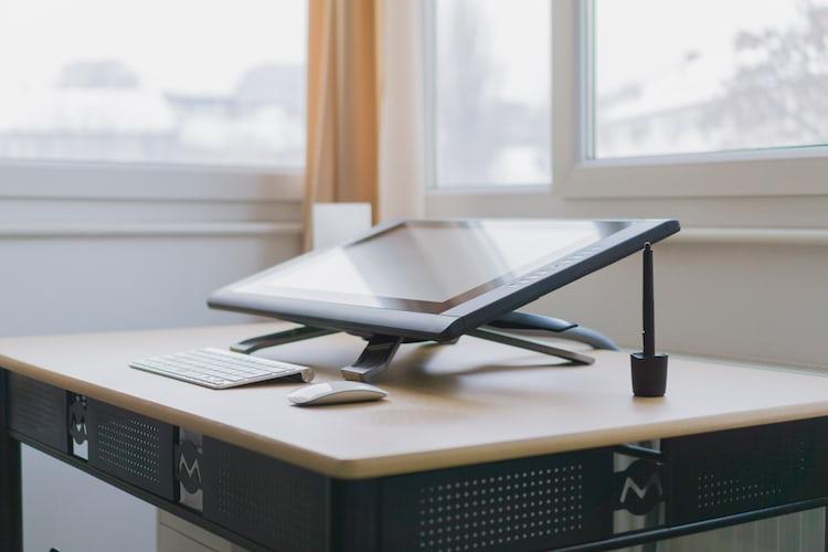 Designer Sketching Wireframes Photo By Green Chameleon Craftedbygc On Unsplash