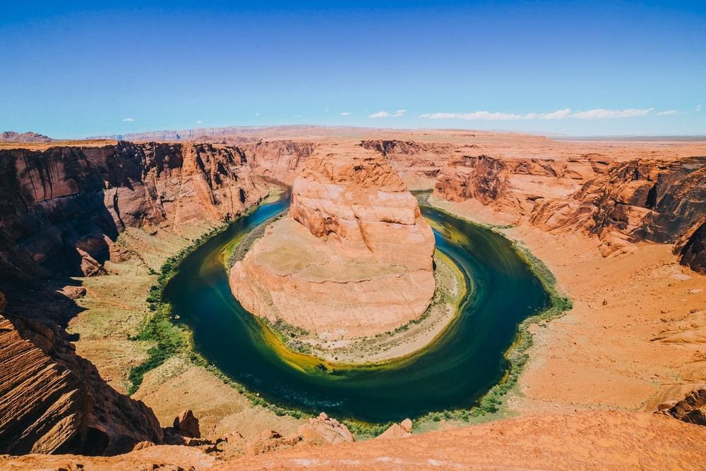 aerial photography of river and mountains