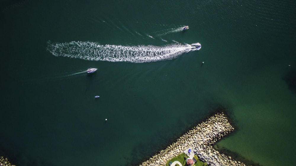 aerial view of speed boat cruising on body of water
