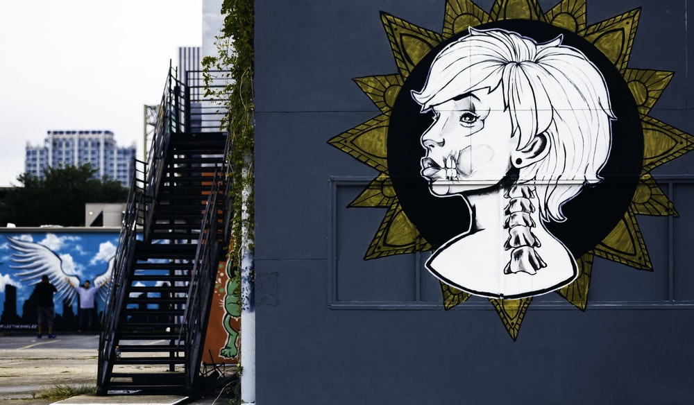 woman portrait painting on wall