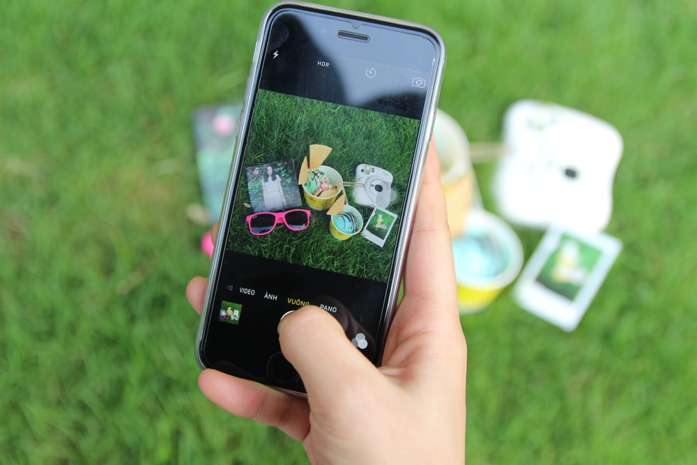 iPhone displaying camera and sunglasses