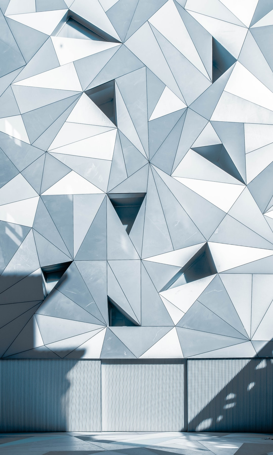 Gray triangles on a facade