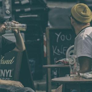 two men drinking beers