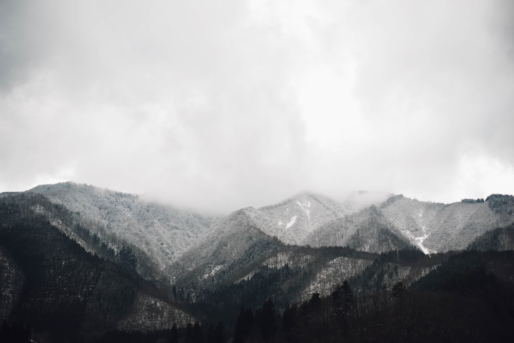 grayscale photo of mountain at daytime