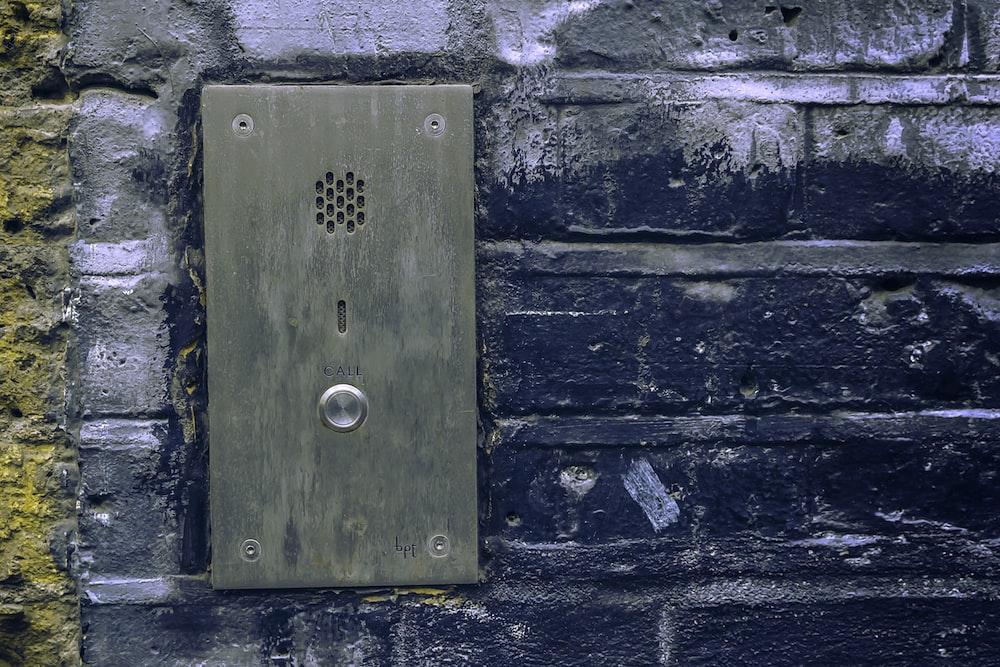 close-up photo of grey door bell