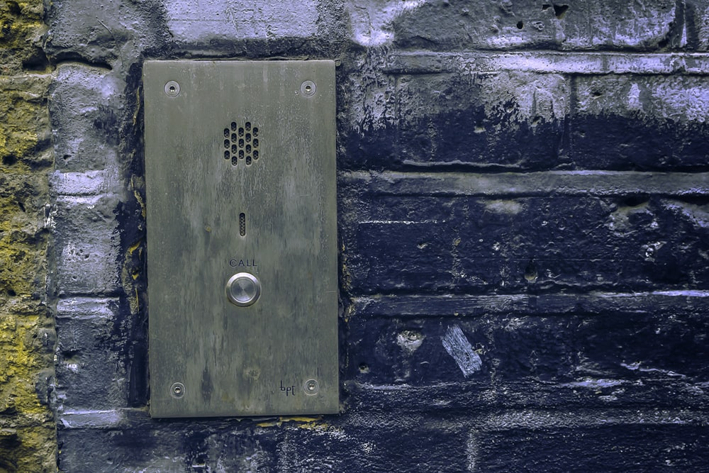 close-up photo of grey door bell