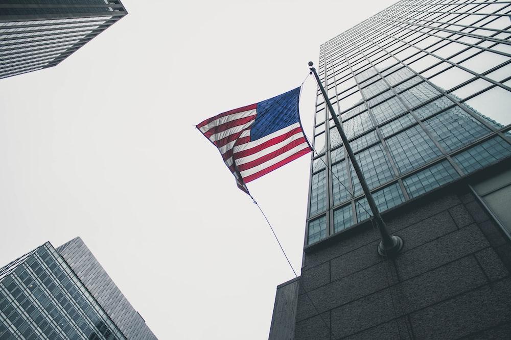 flag of America waving under gray skies