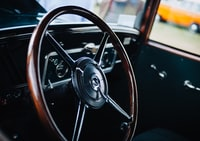 closed up photo of brown and black vehicle steering wheel