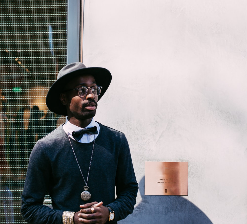 man in black sweatshirt and hat