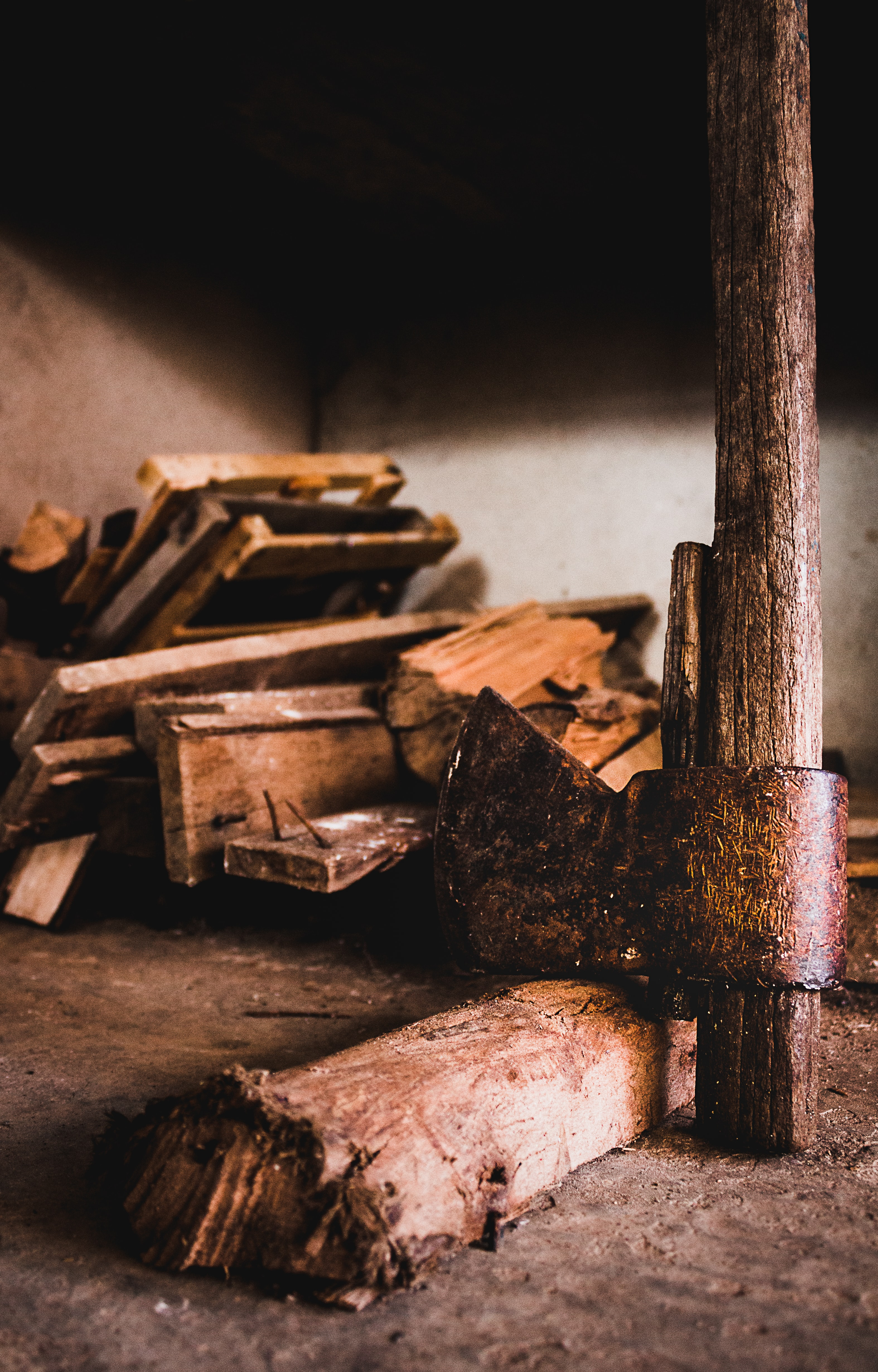 An old axe and a stack of firewood.