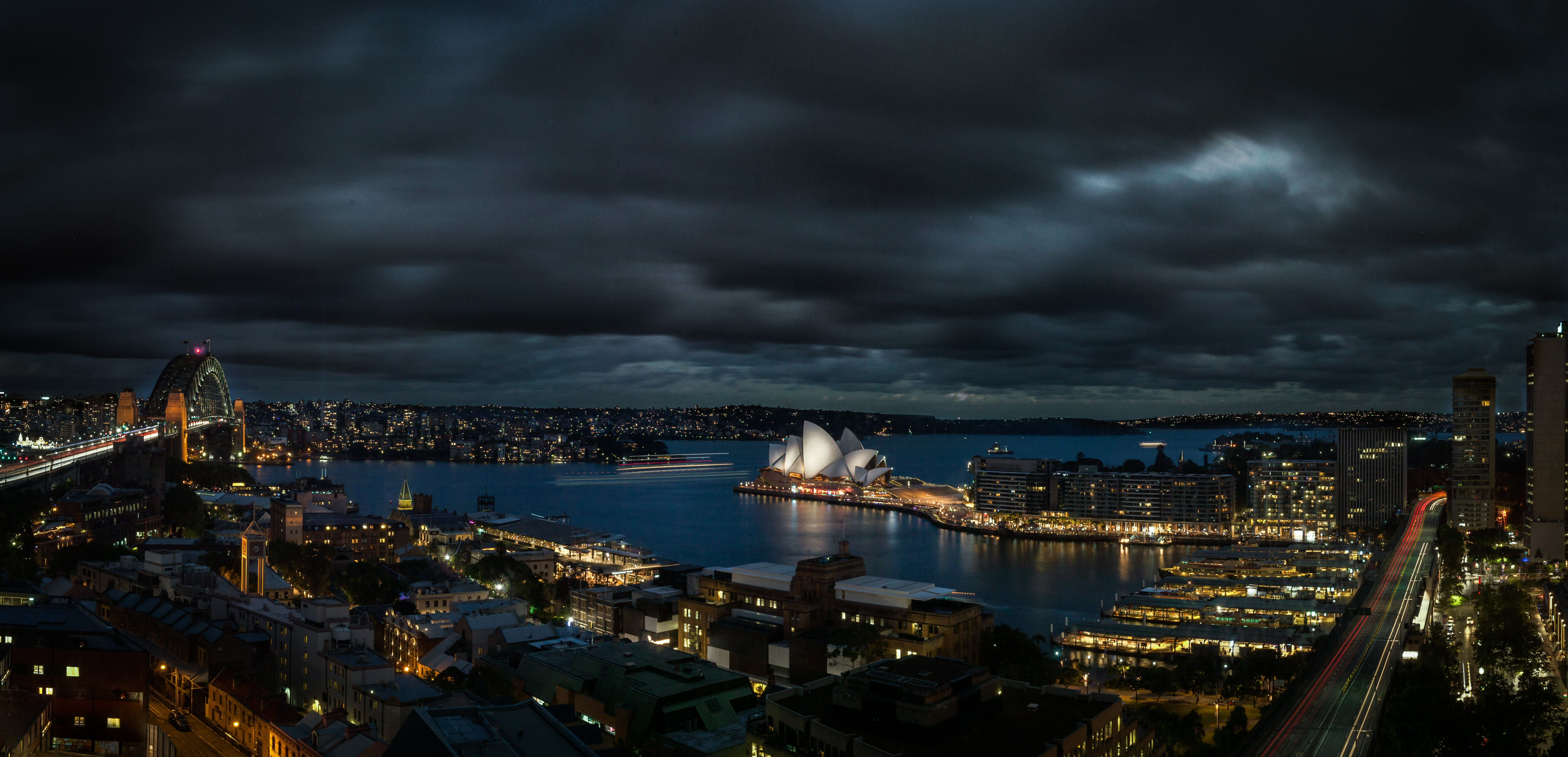 A cityscape shot on a dark cloudy night with Sydney as the backdrop
