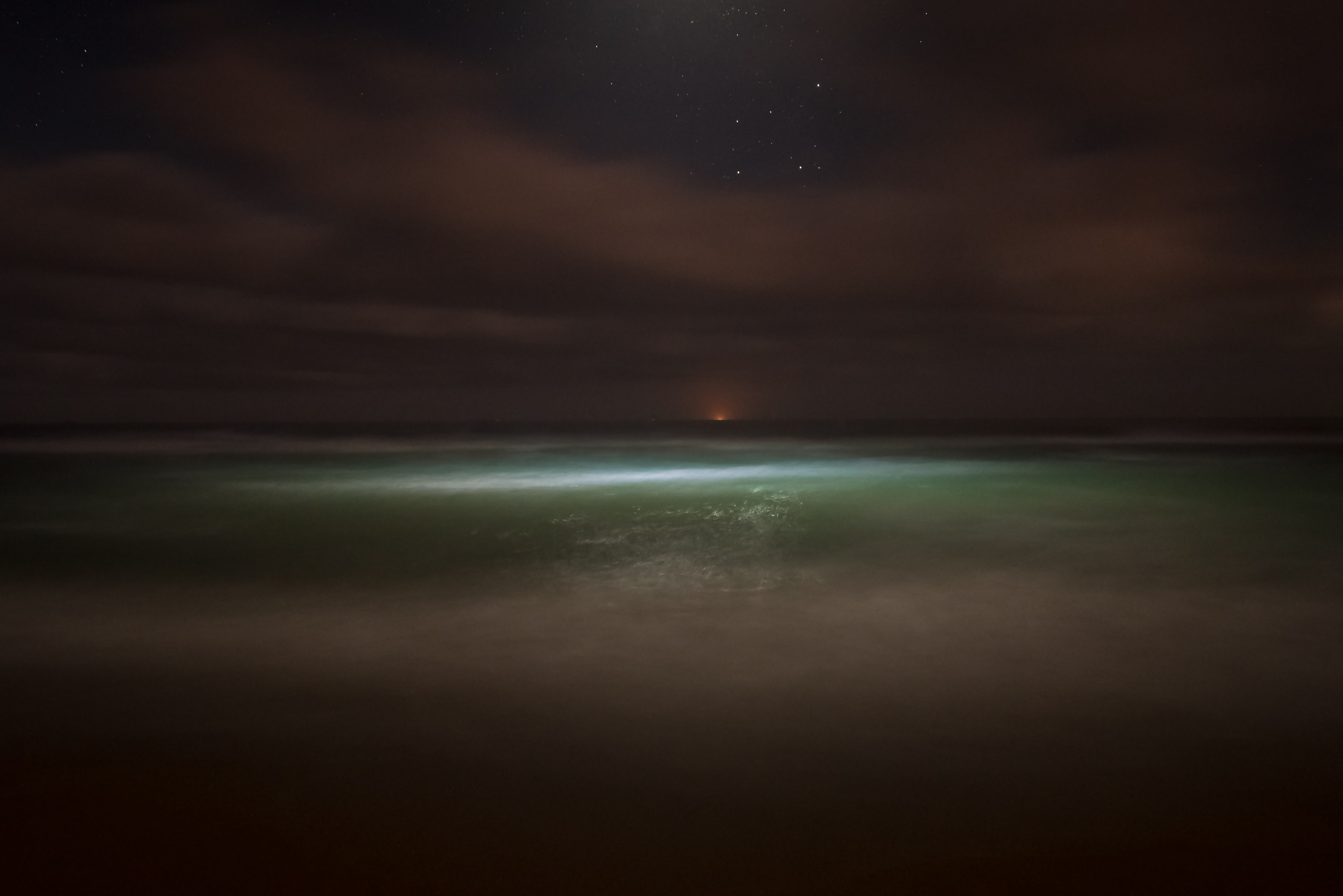Ocean and a starry sky at night at Stockton Beach