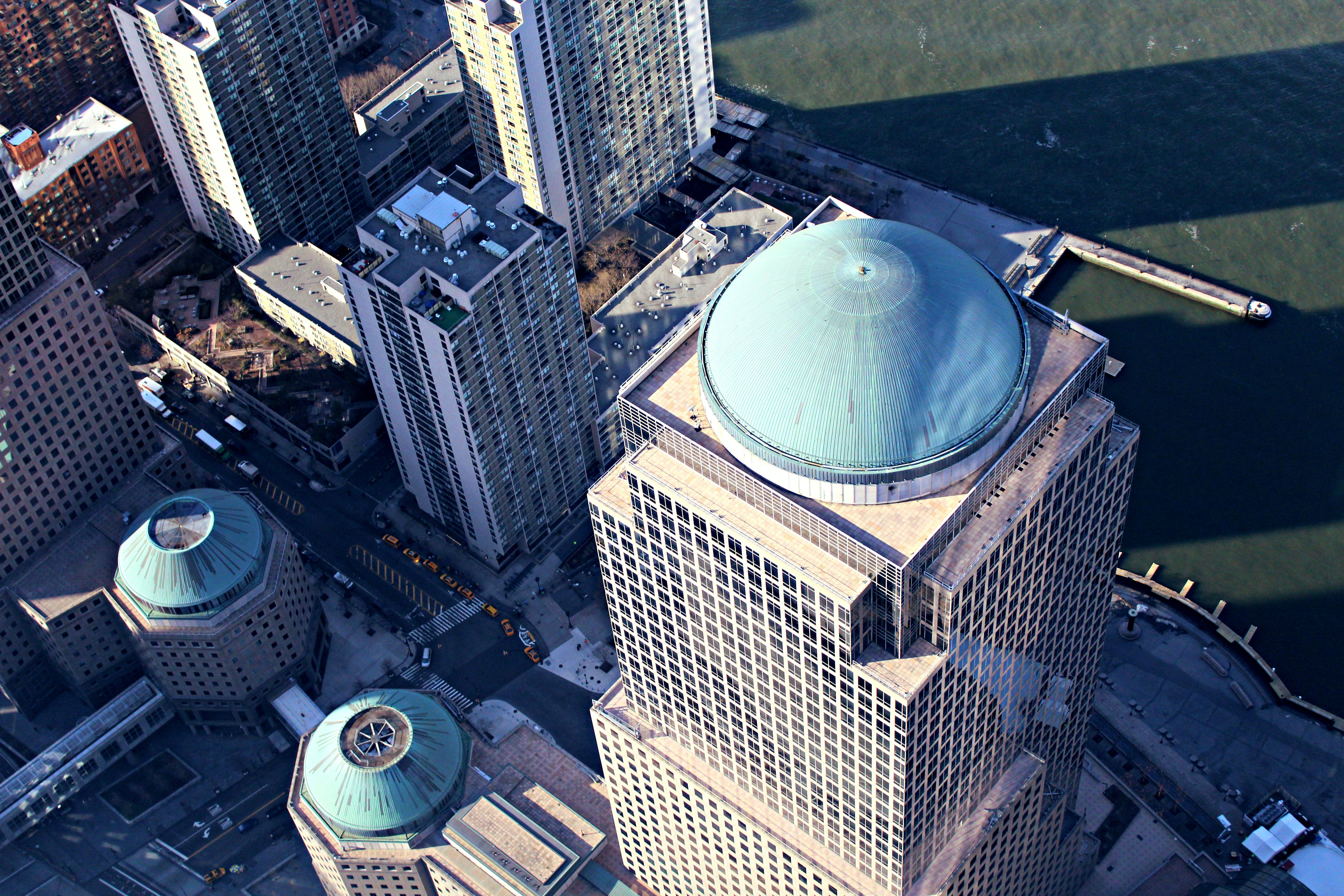 View from a skyscraper window on domes on high-rises below