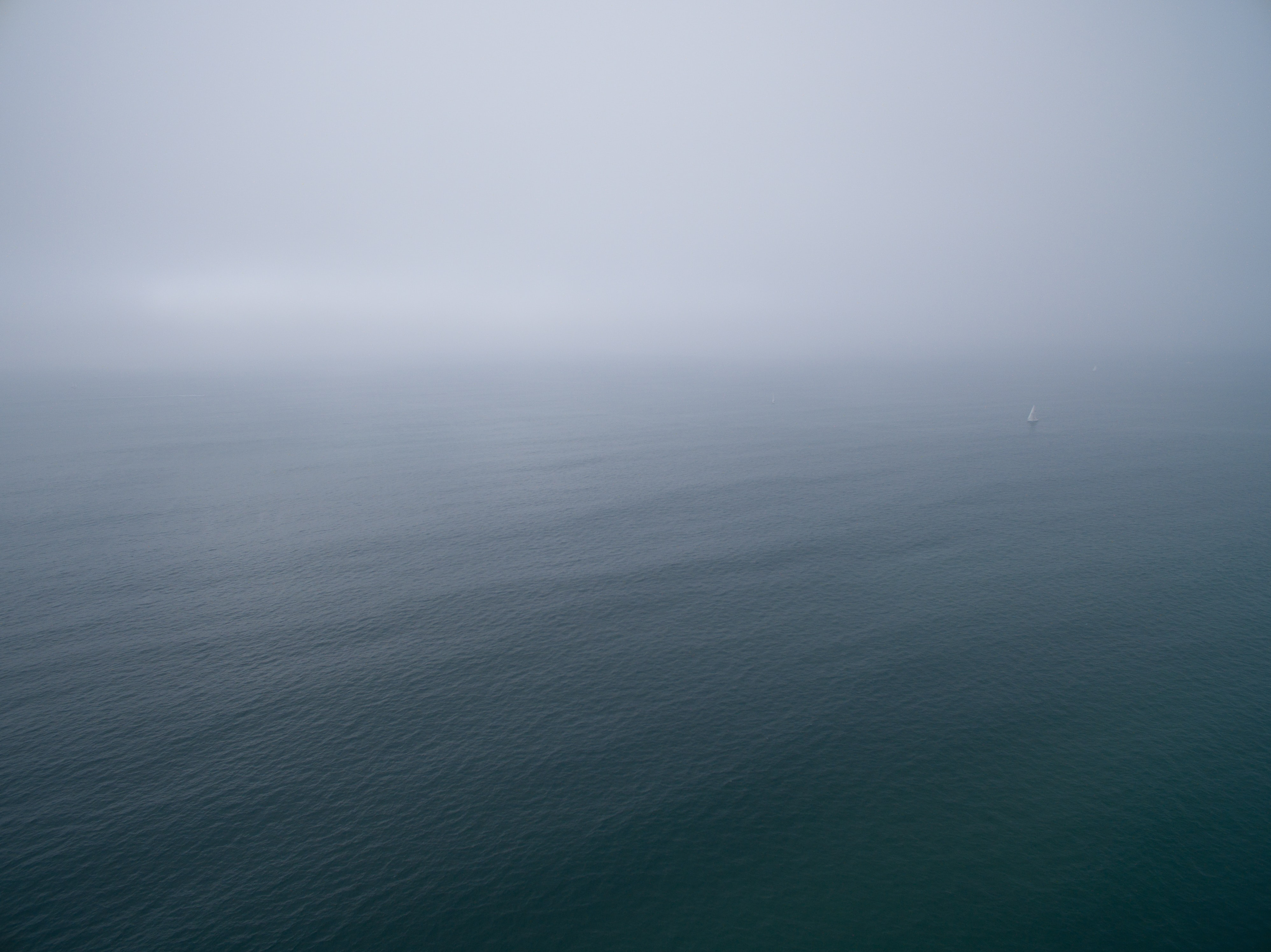 top view of ocean under grey clouds