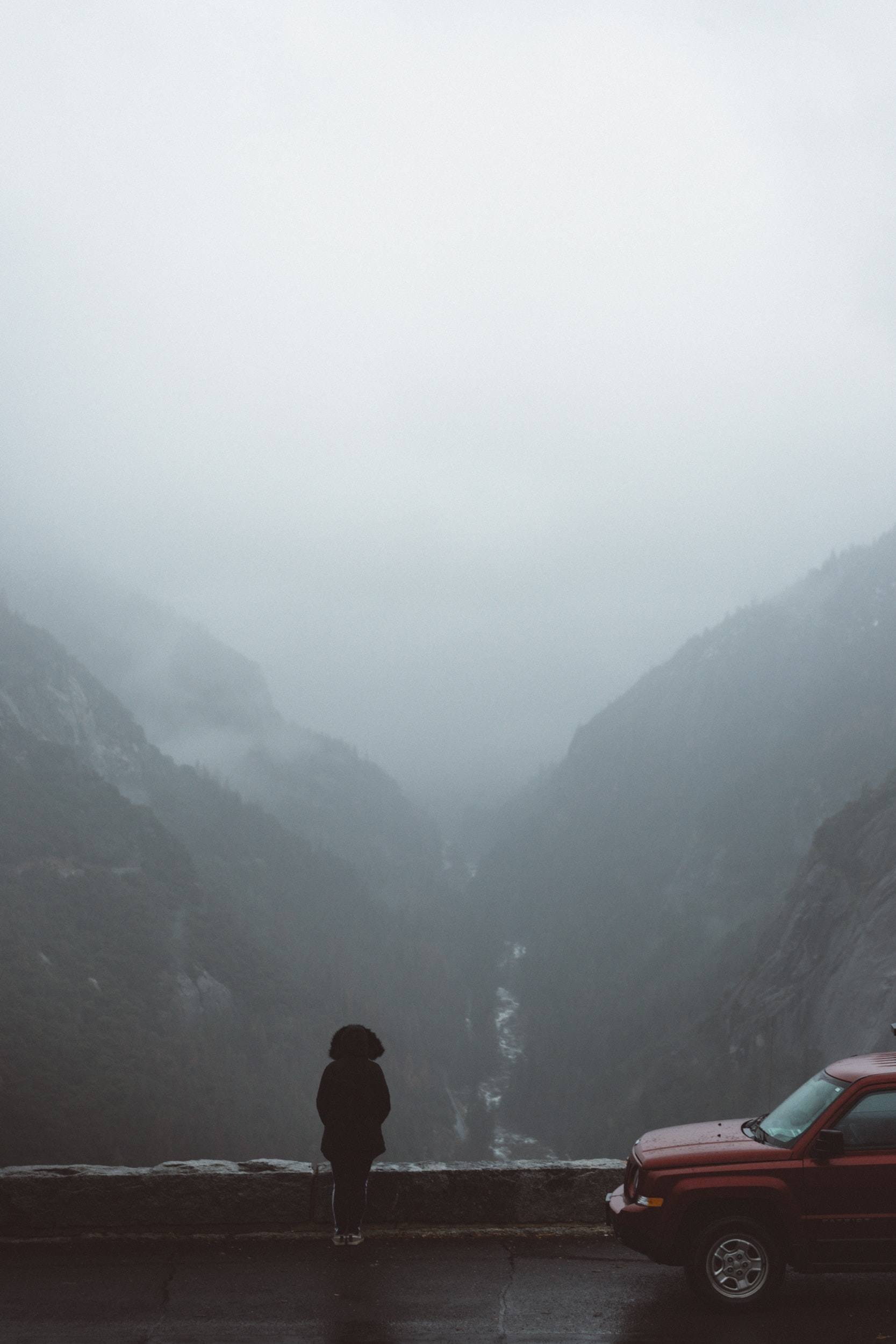 Stopped on the side of a road overlooking foggy mountainscape