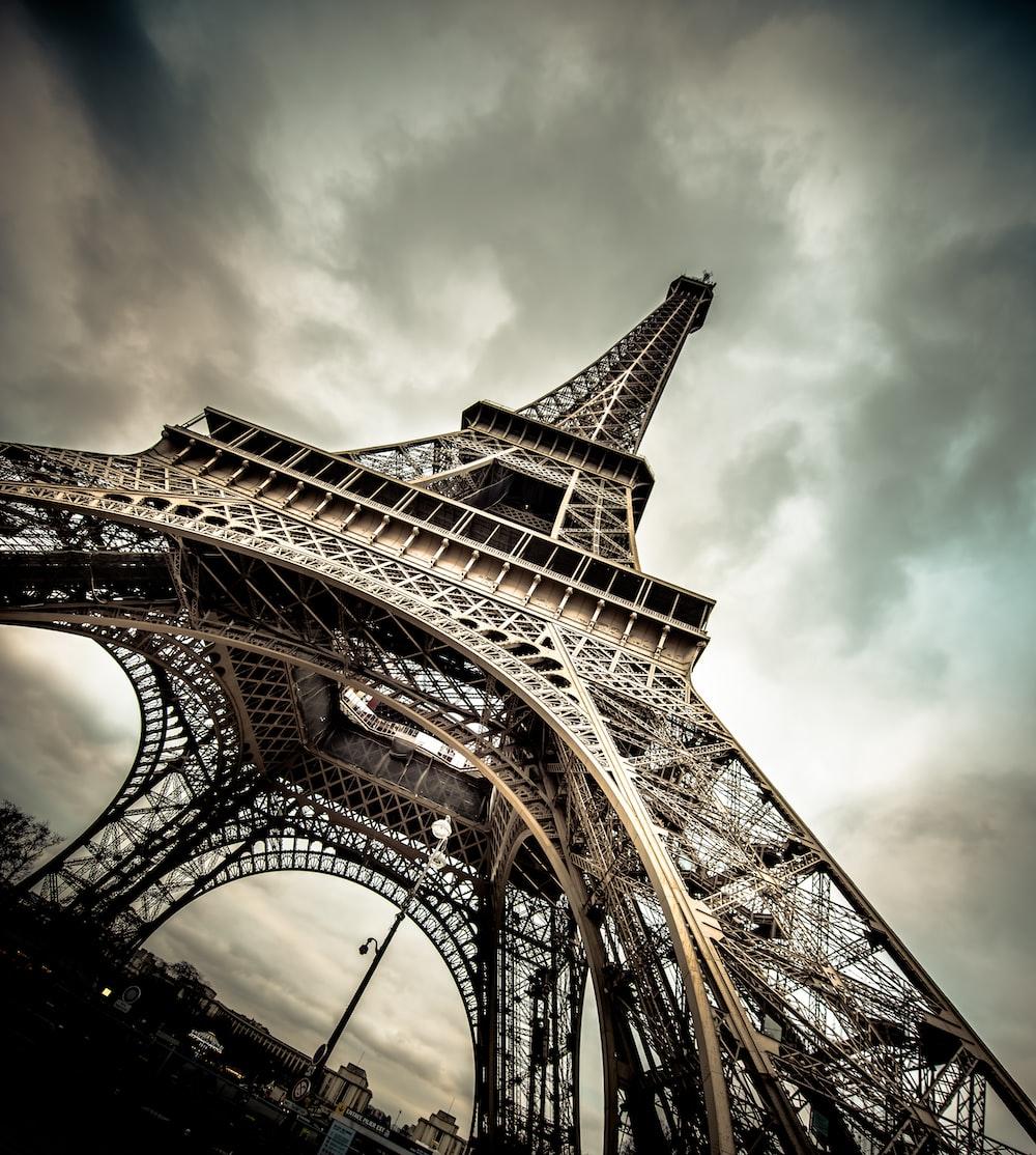 eiffel tower under gray cloudy sky