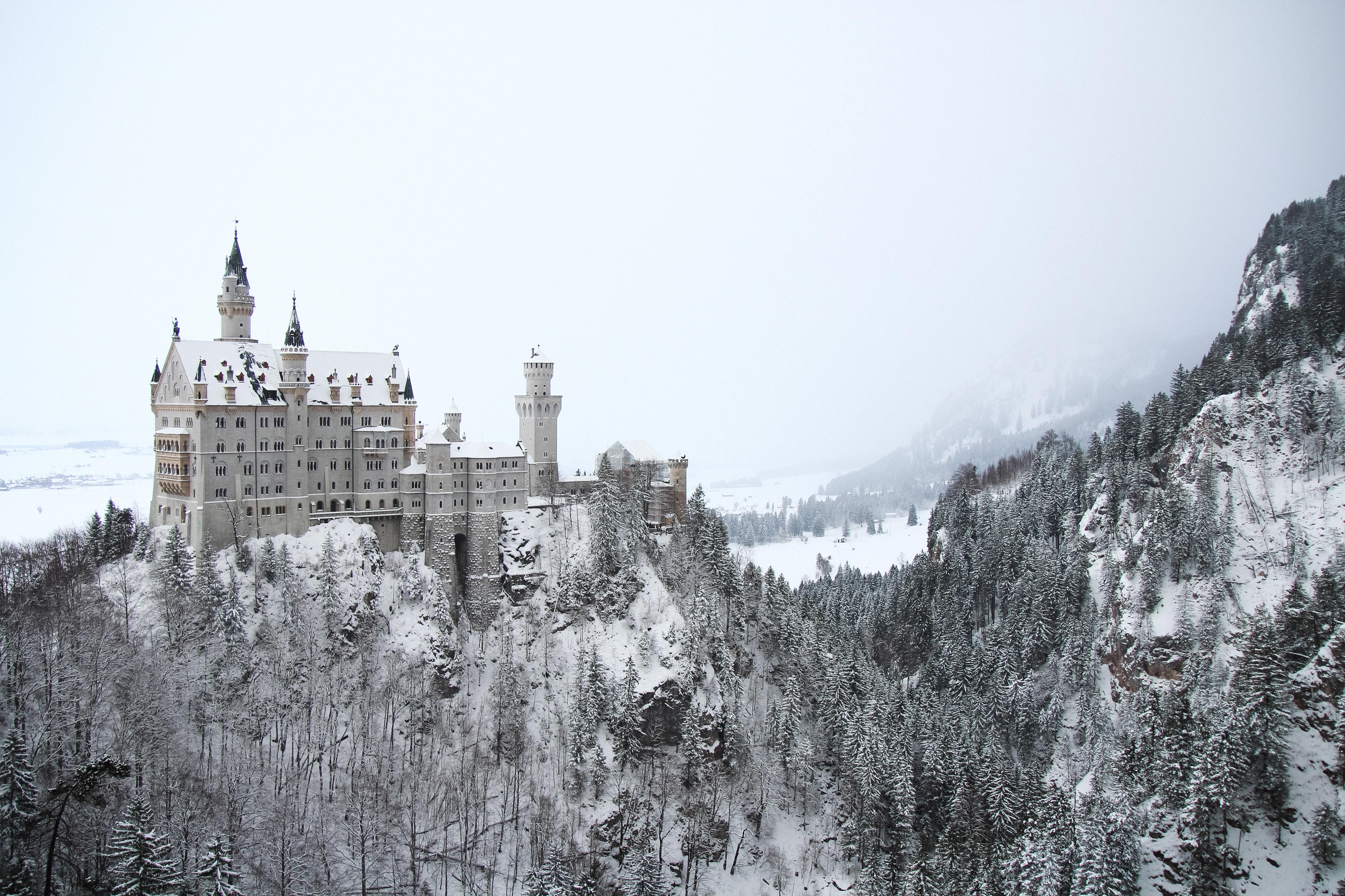 Neuschwanstein castle on a snowy hill