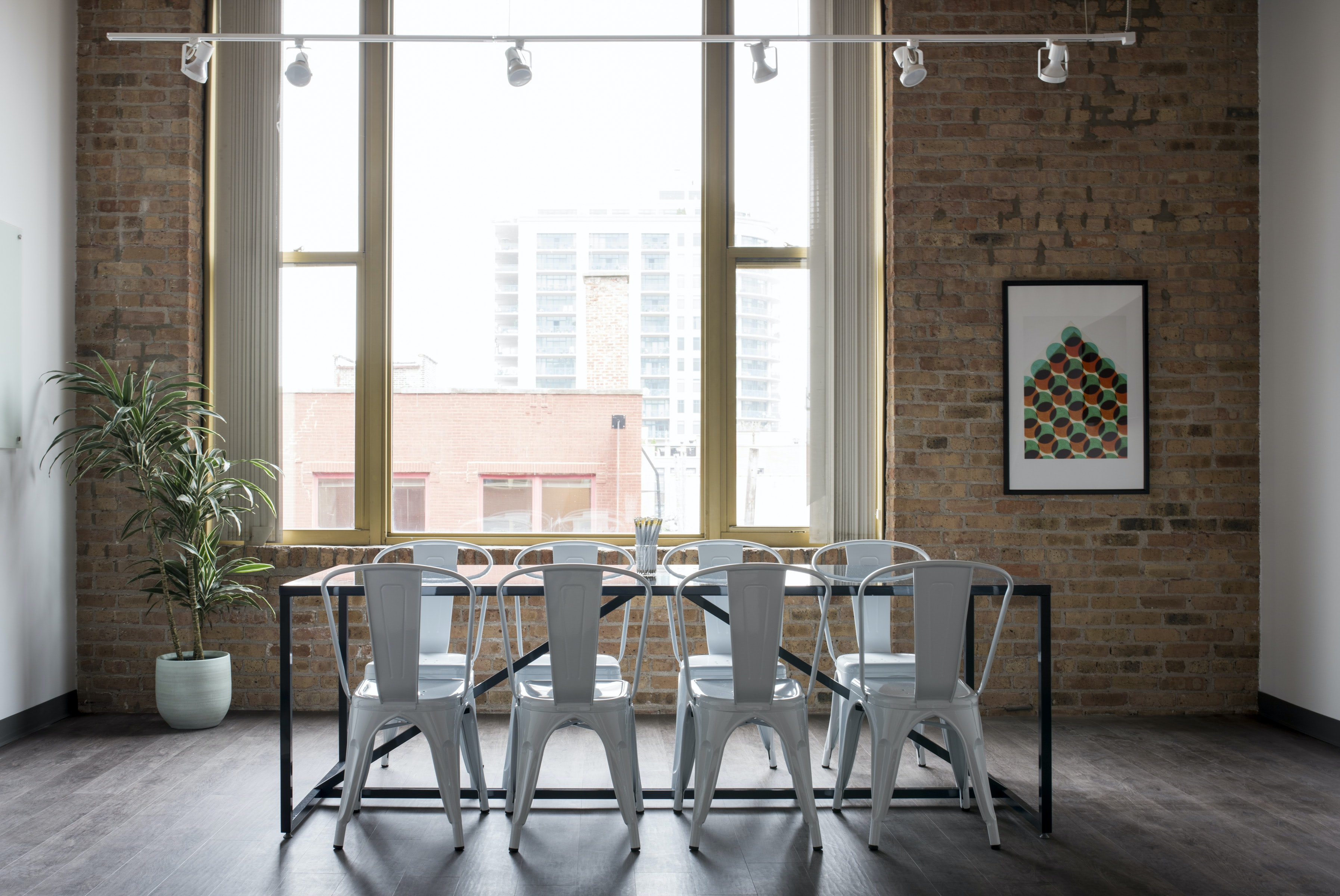 Plastic chairs at a table in a small meeting room