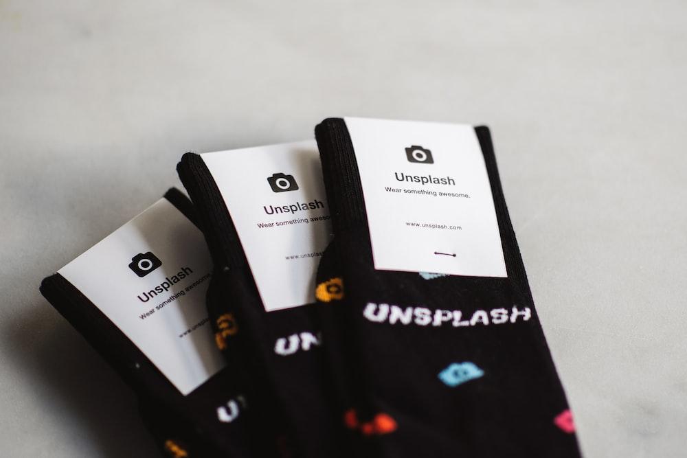three pairs of black Unflash socks
