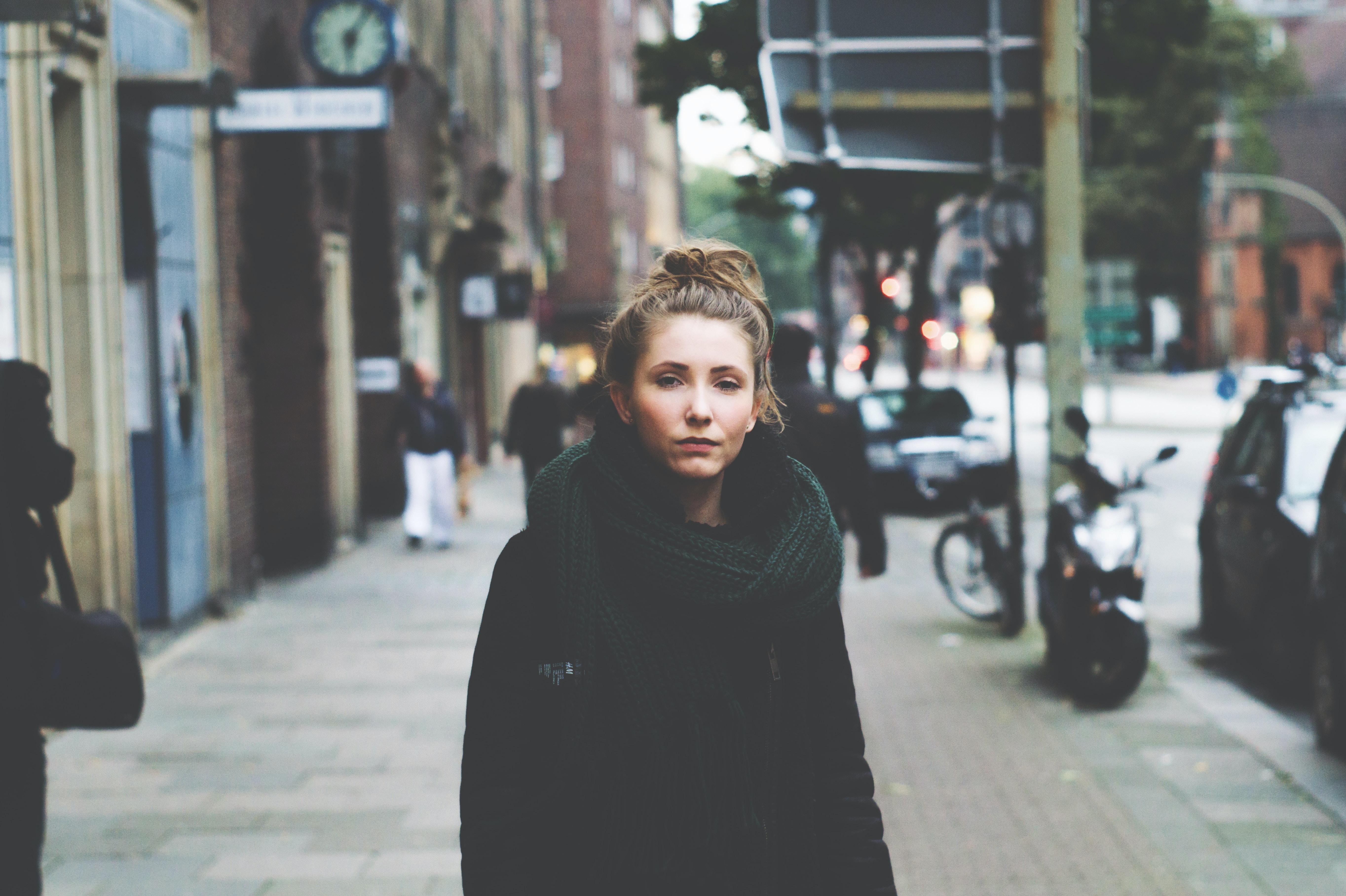 woman standing on sidewalk