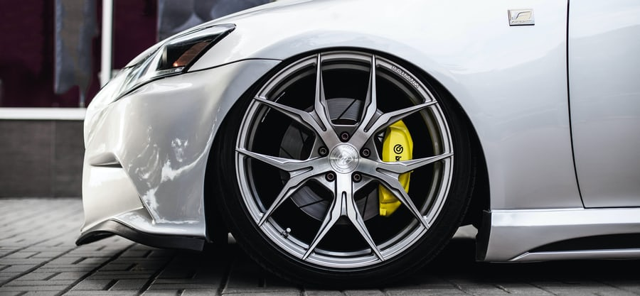 silver car with brembo brakes