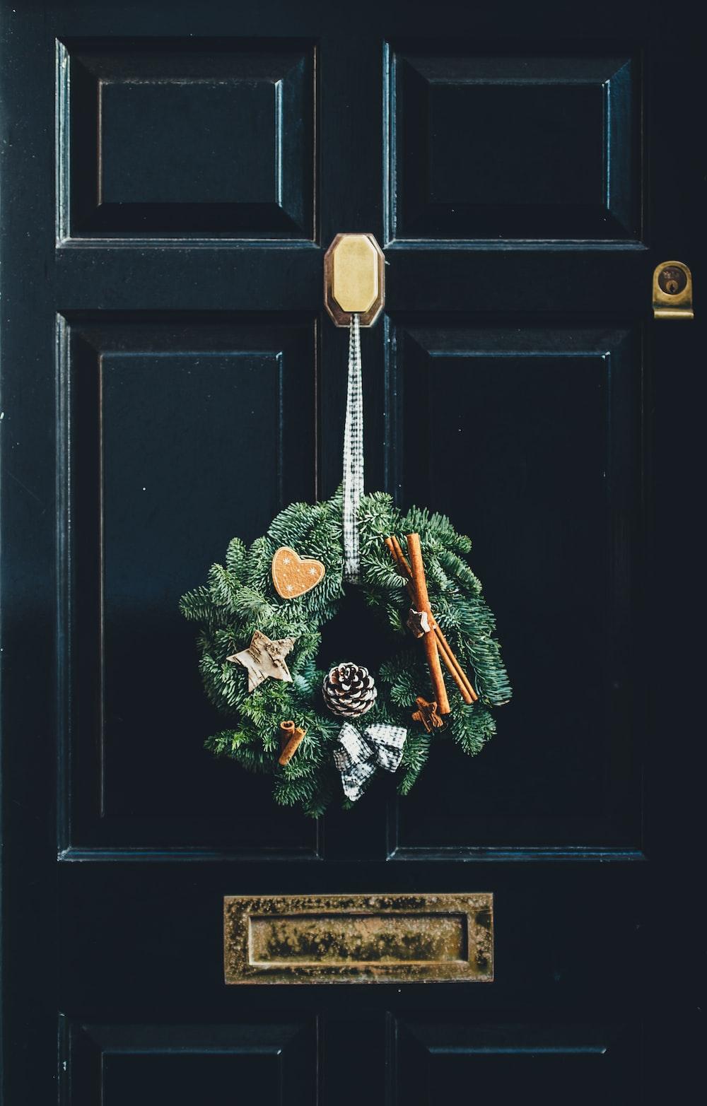 green wreath hang on door