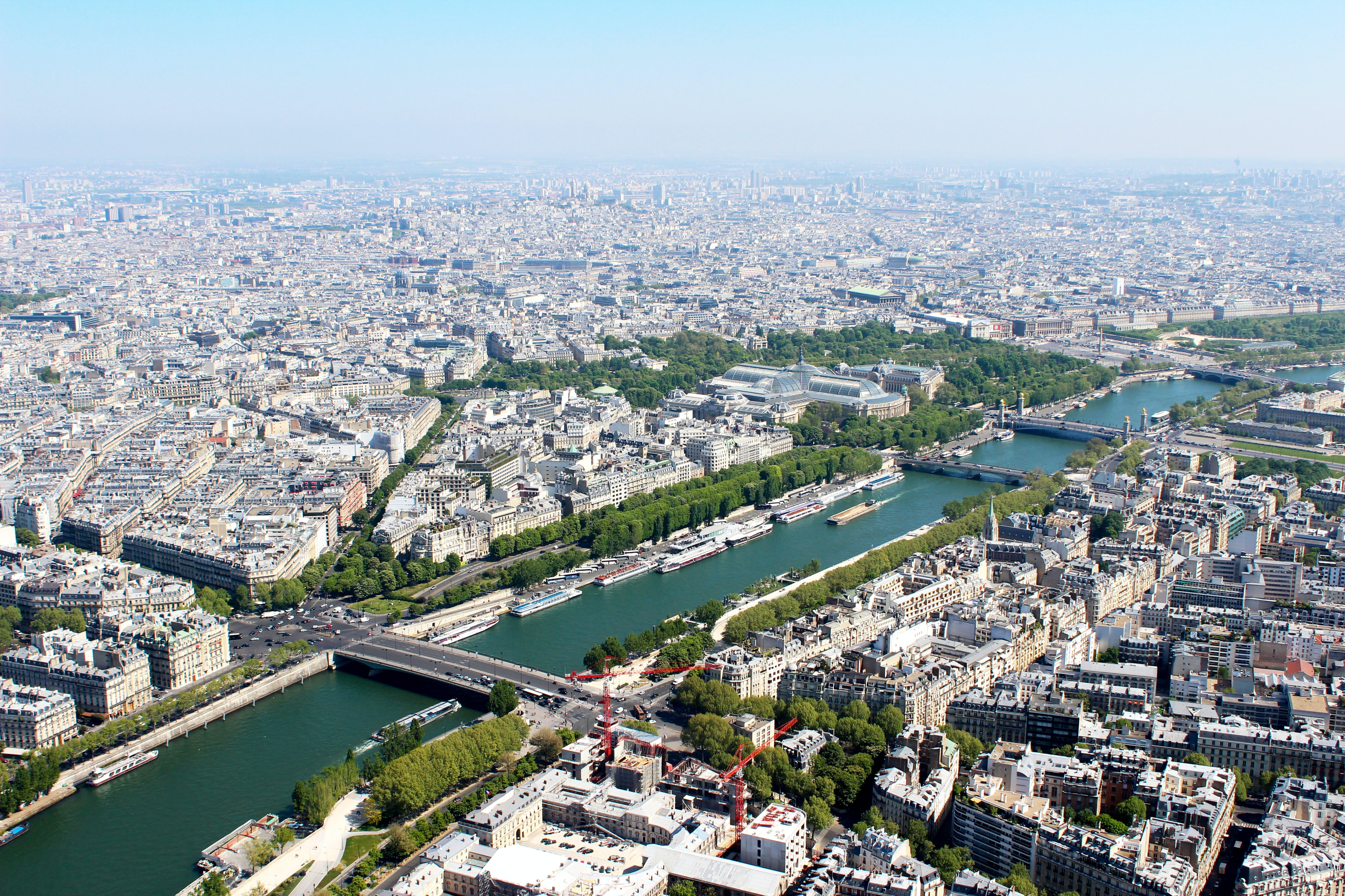 A drone shot of Paris and the Seine River on a sunny day