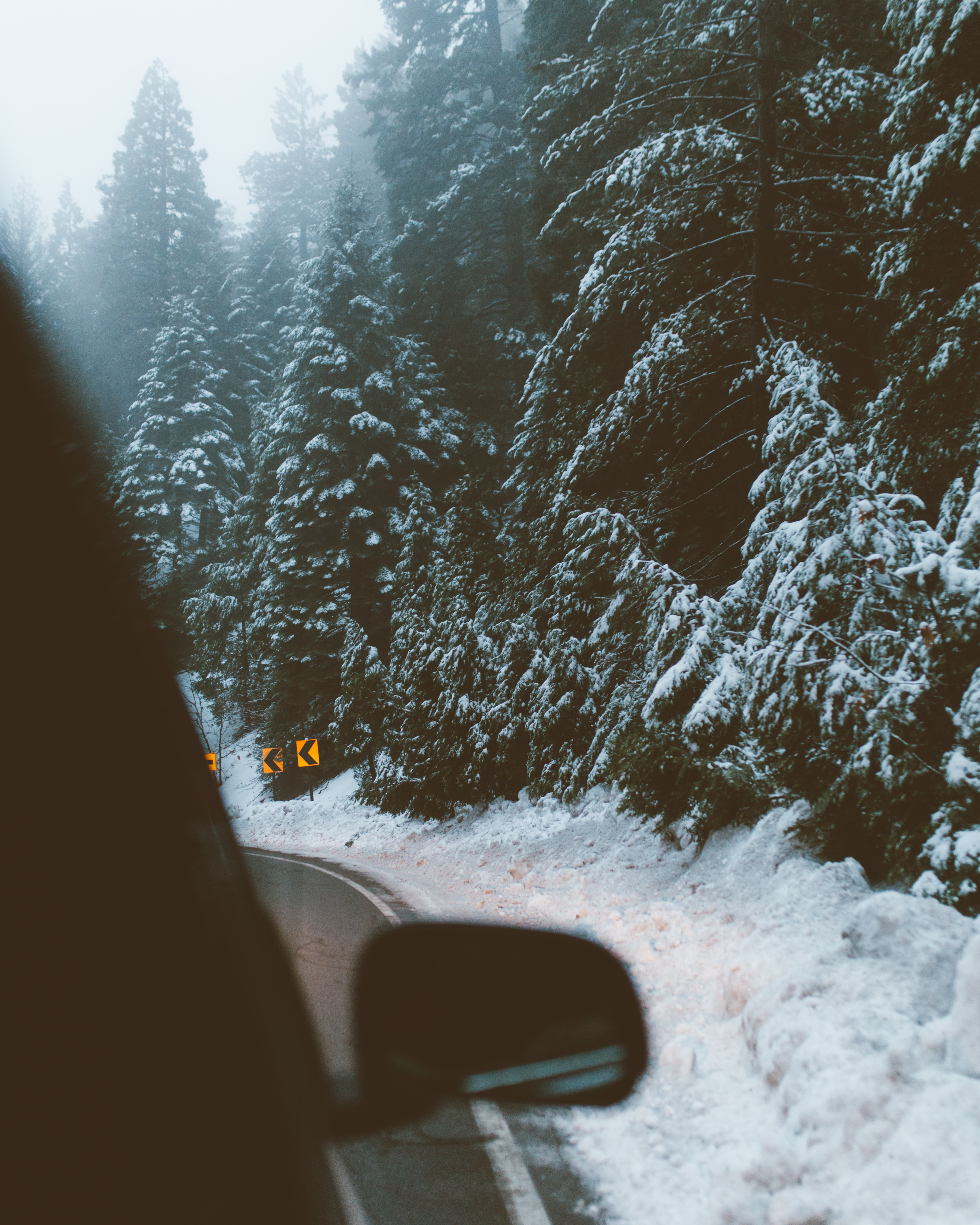Driving around a turn on a forest road in the winter at Lake Arrowhead in California
