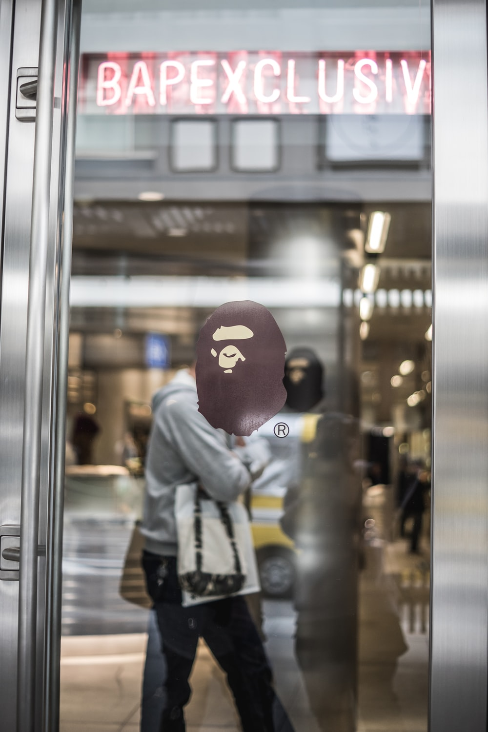A Bathing Ape decal on glass