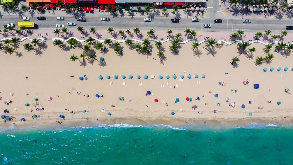 aerial photography of coastline with people