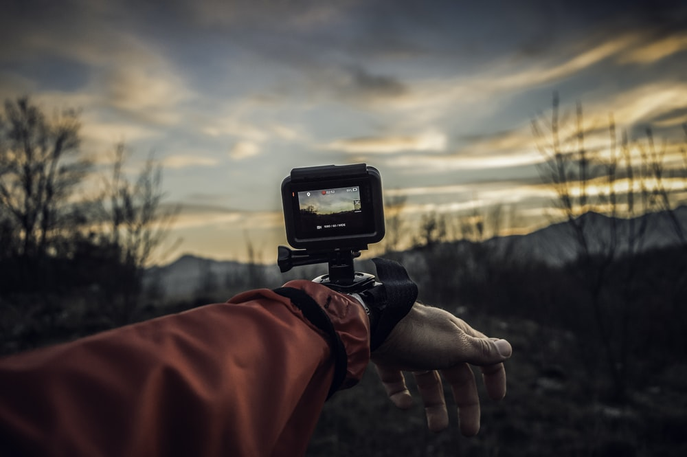person carrying action camera