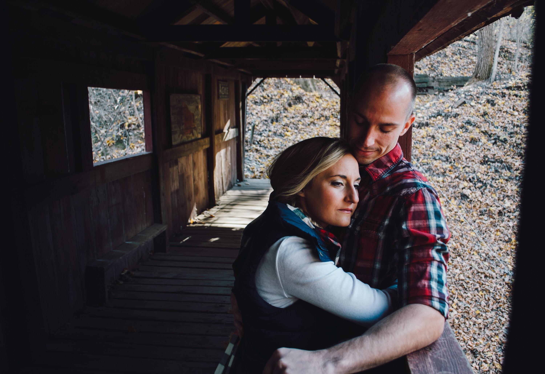 Cozy couple hugging and happy on a bridge