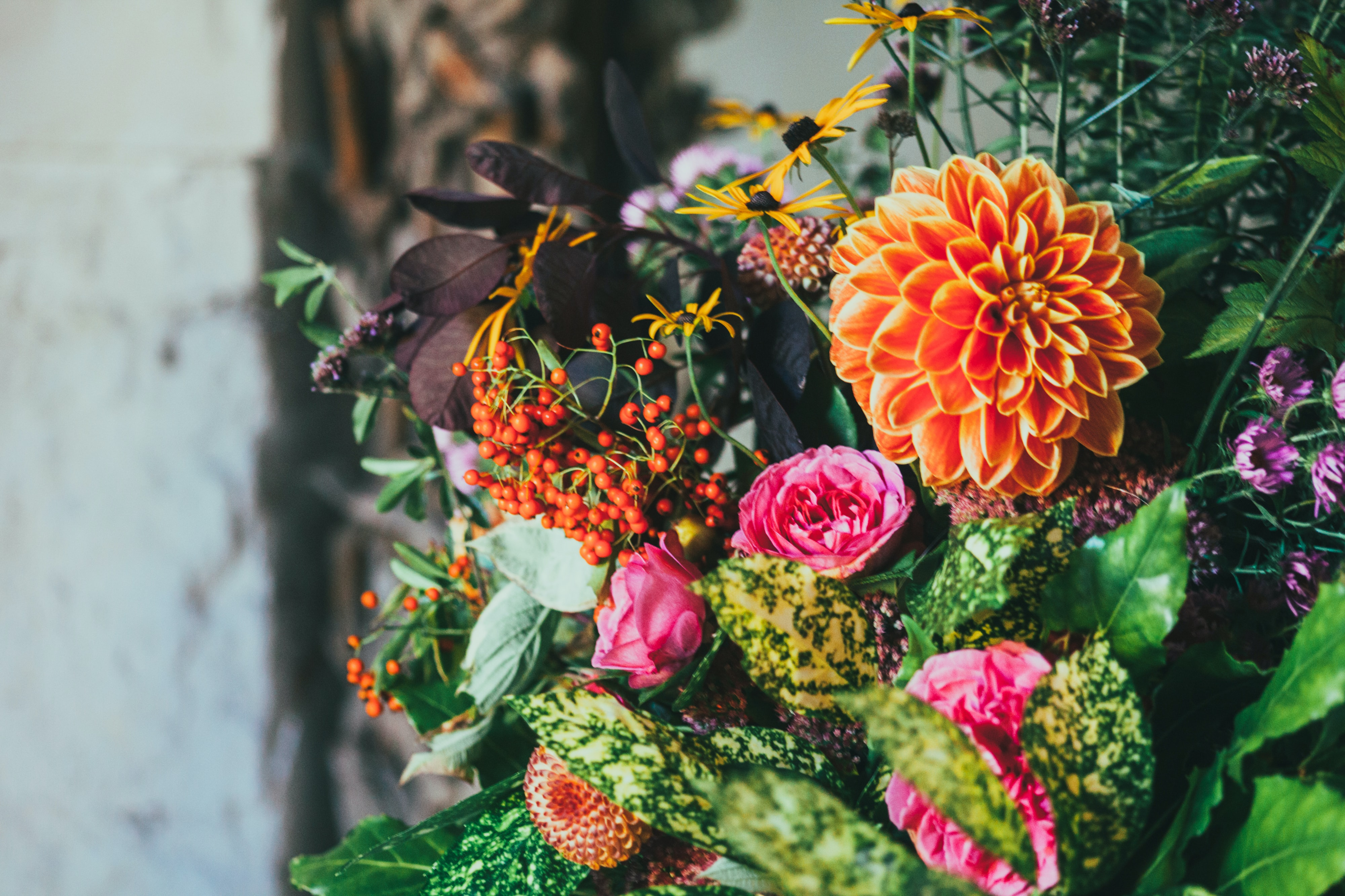 A floral arrangement with dahlias, peonies and rowan berries