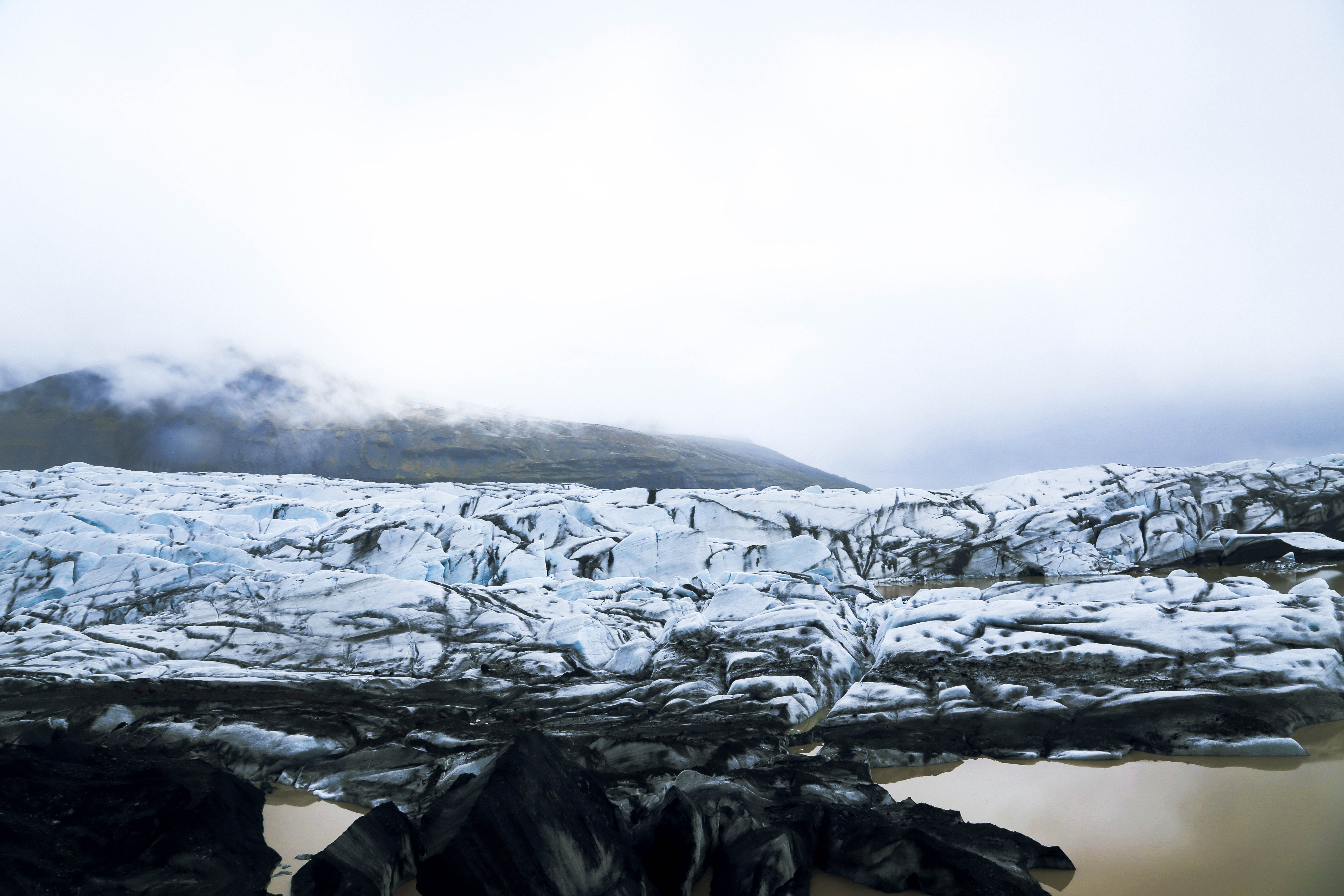 Snowy glaciers cracked with ice in Skaftafell