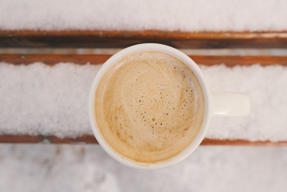 cup of cream frothed coffee