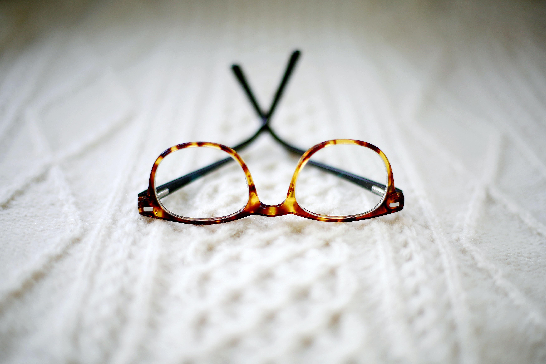 closeup photo of brown framed eyeglasses