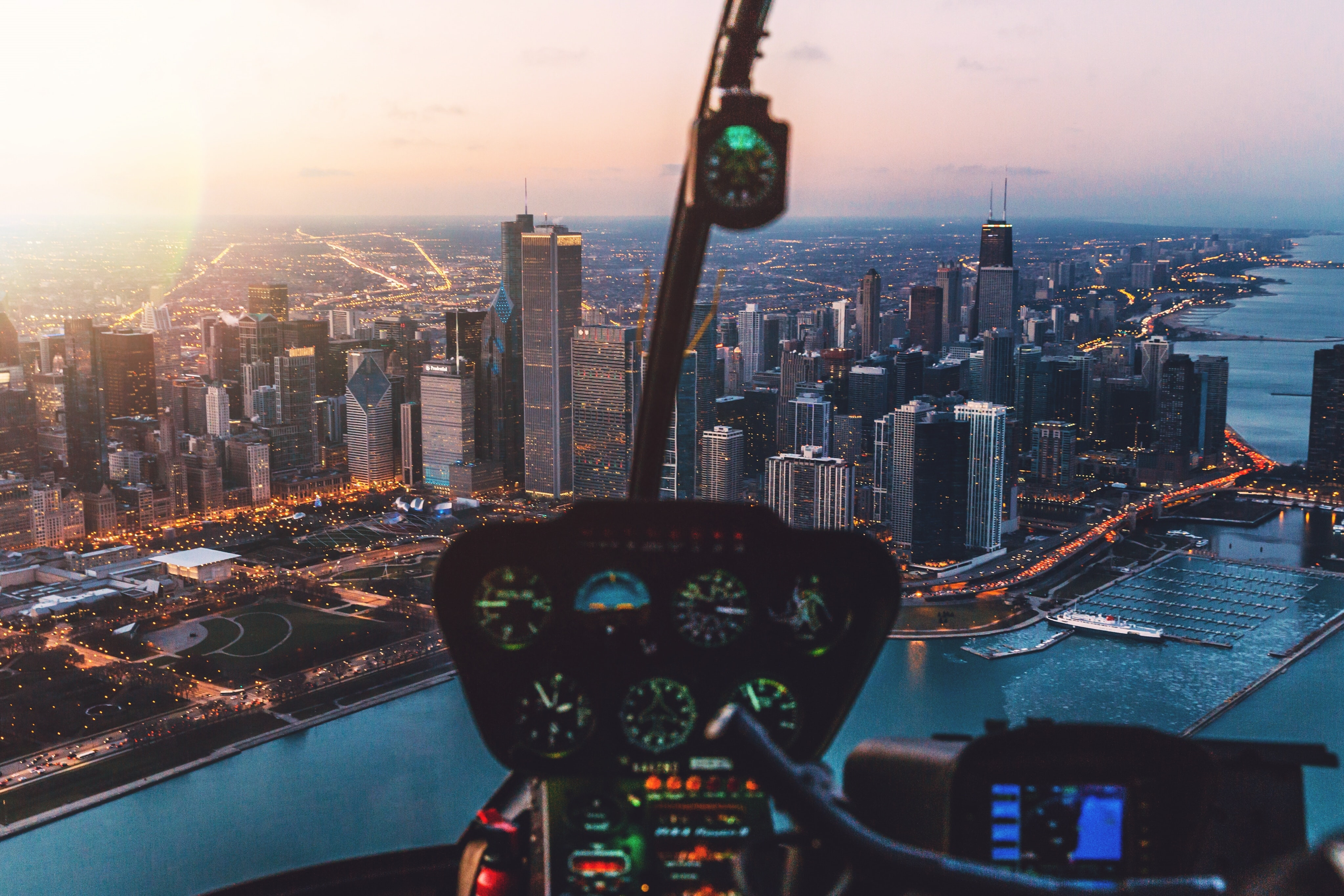 View from an airplane cockpit on the skyline of Chicago at night