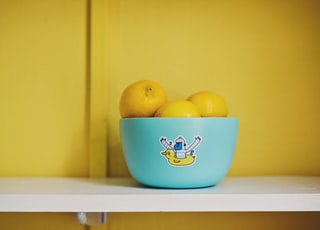 lemon fruits on teal bowl