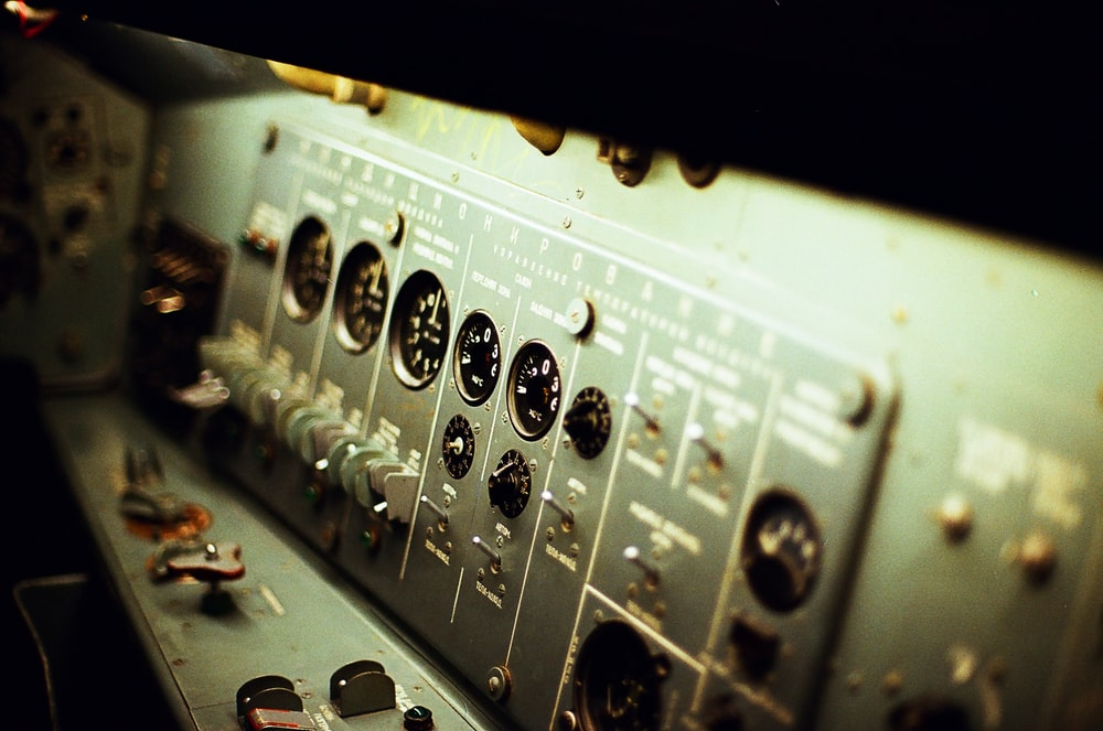 selective focus photography of grey electronic control panel