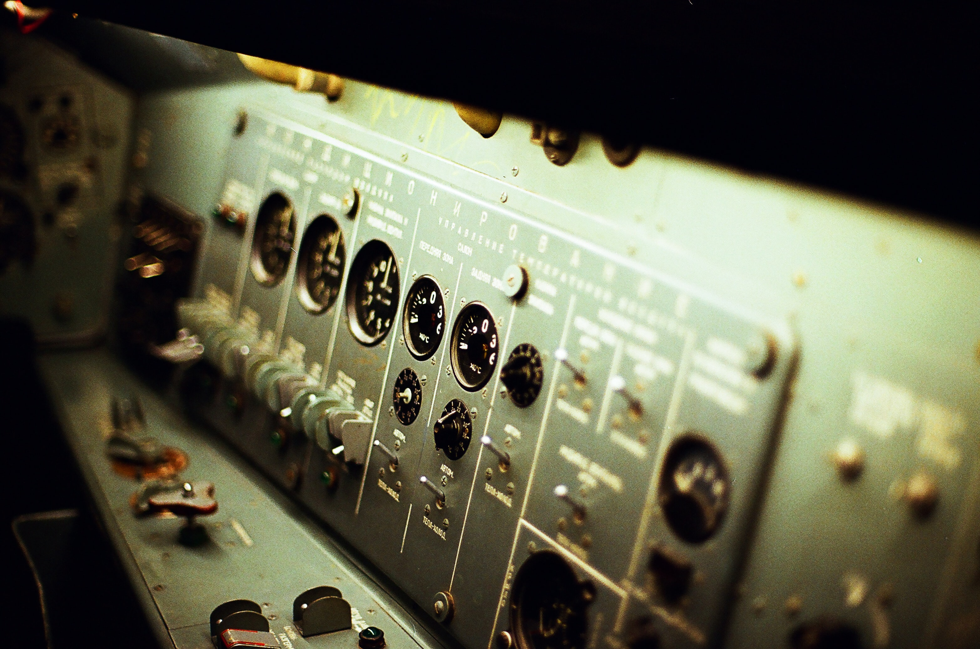 An old Russian control panel with various dials and knobs
