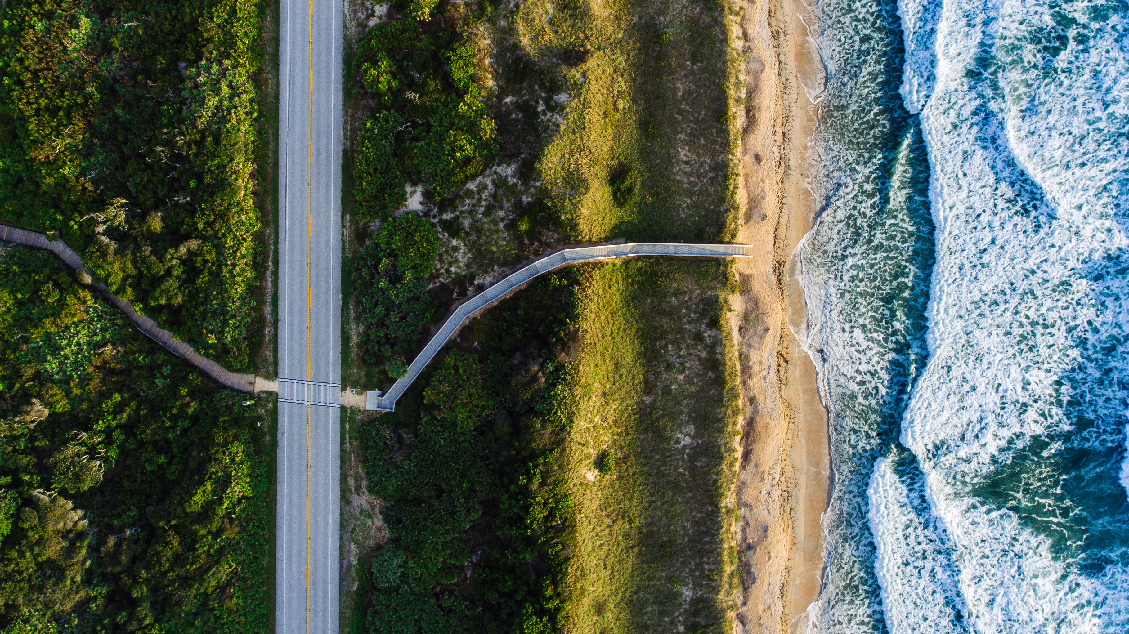 Drone aerial view of a road along the sand beach coastline at Ponte Vedra Beach, Florida, United States