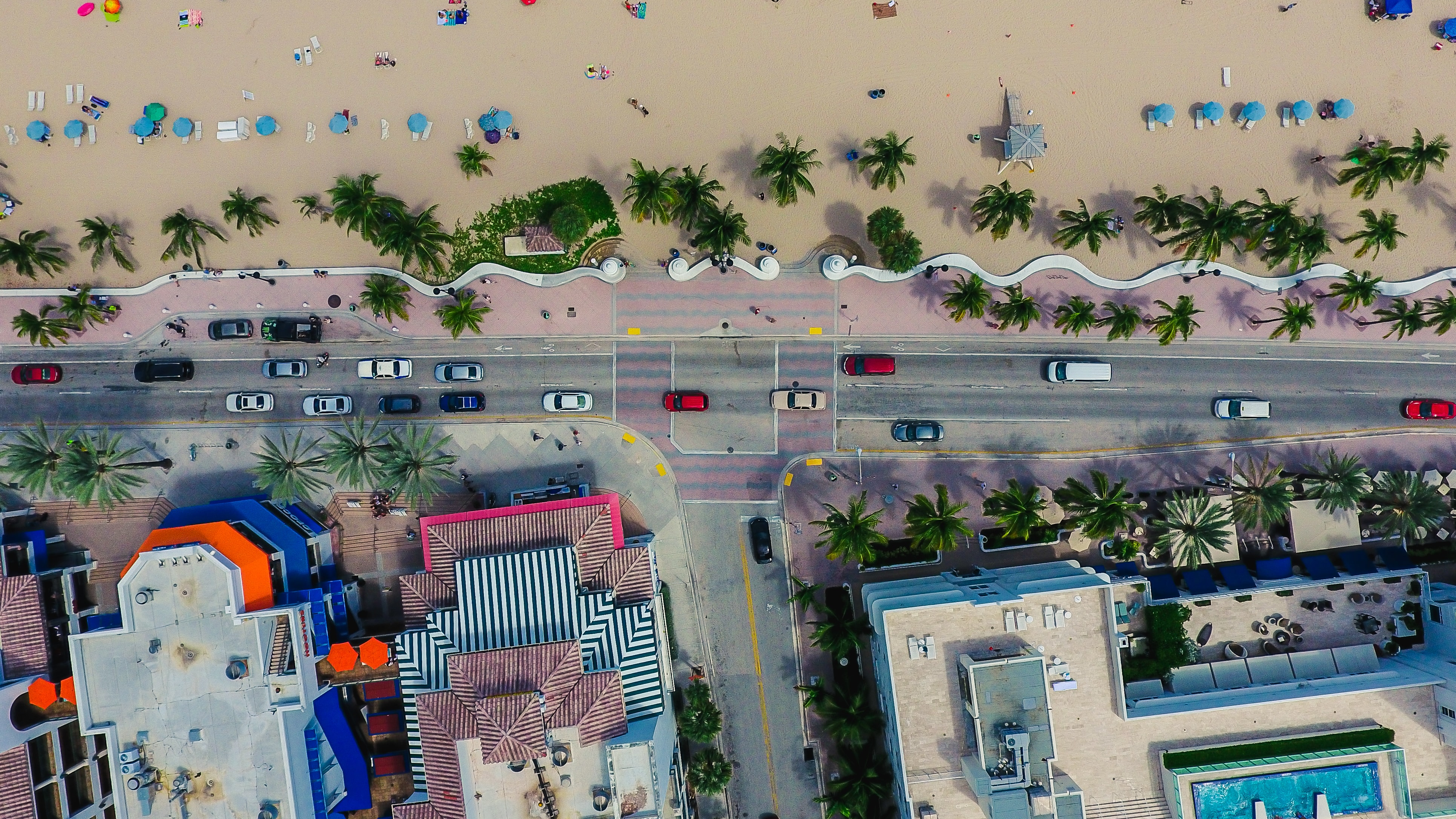 Drone view of the busy street by the sand beach in East Fort Lauderdale, Fort Lauderdale, Florida