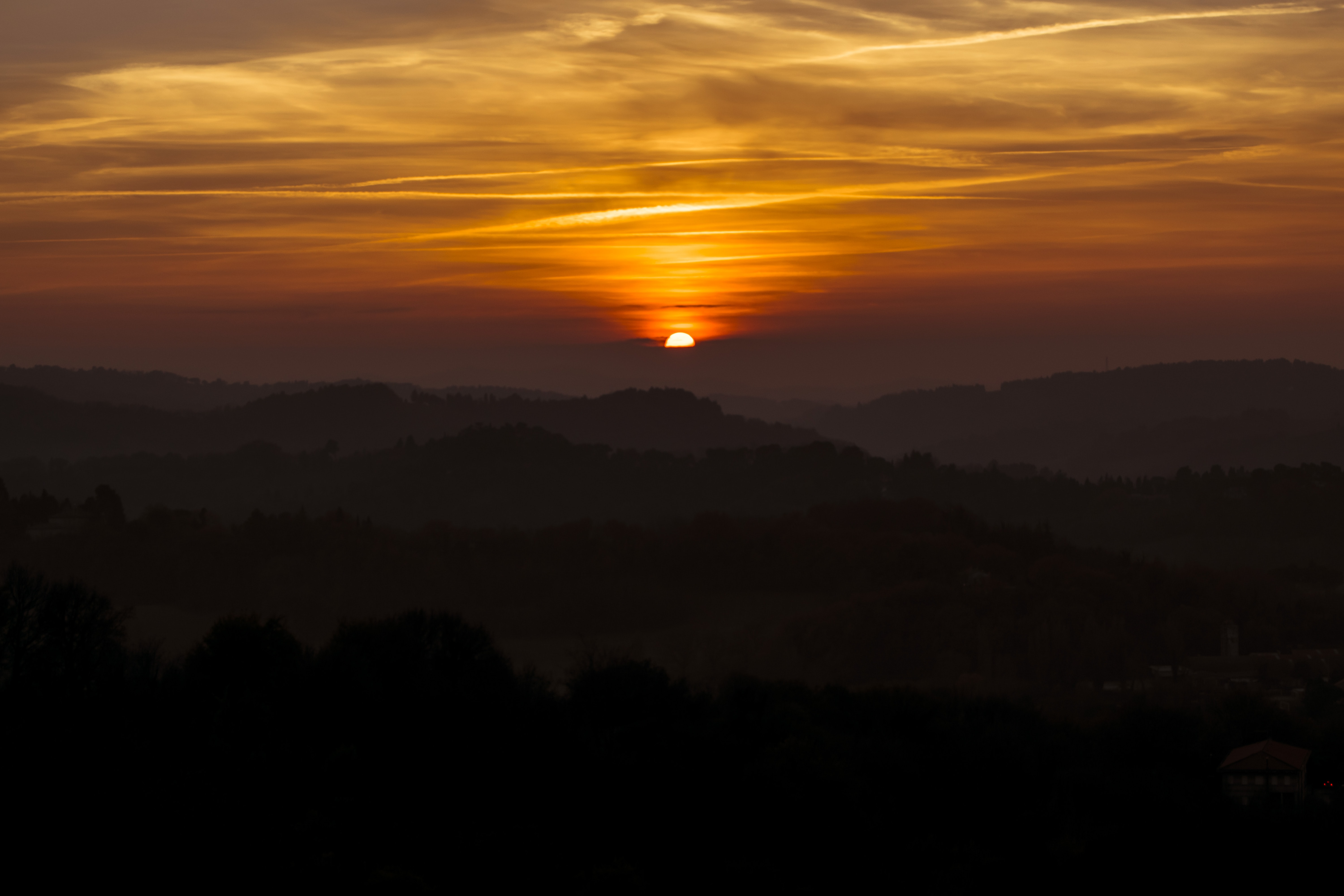 silhouette of mountains on sunset
