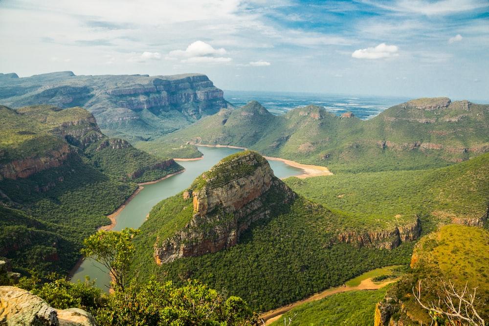 landscape photography of mountains under blue sky