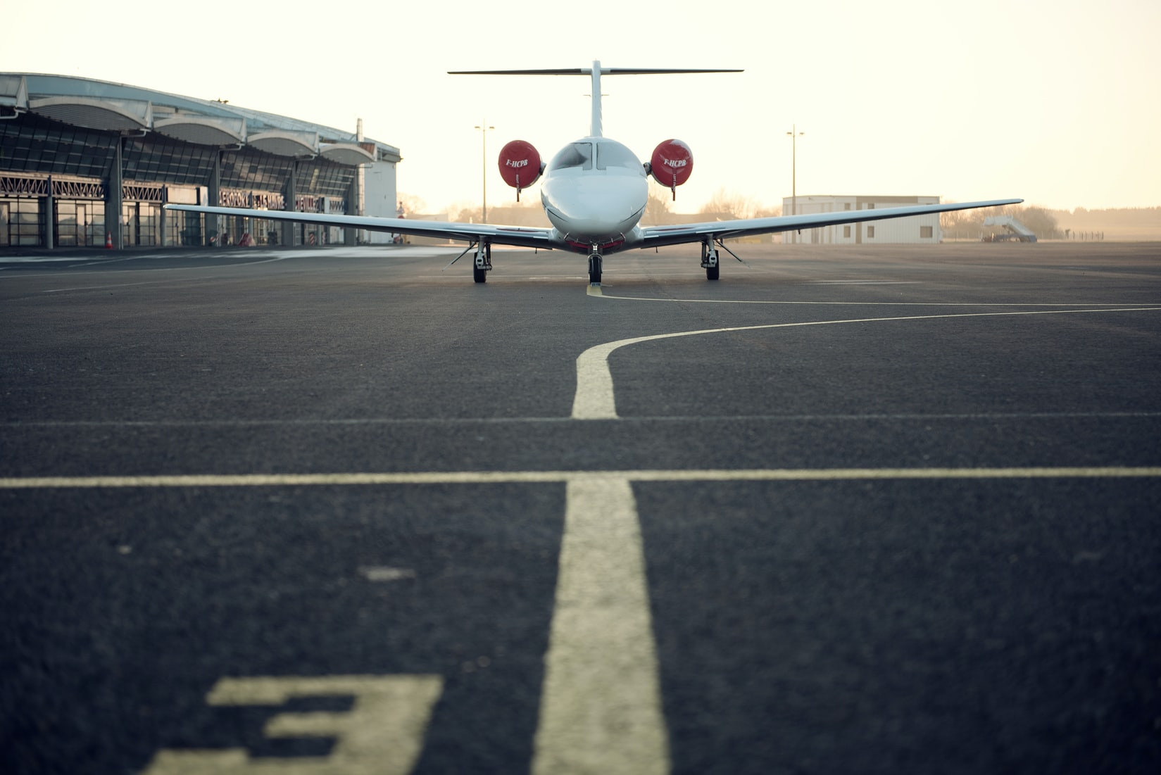 A small plane on an airport runway