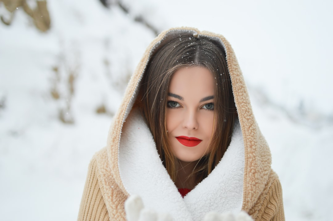 Hooded woman in snow